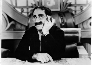 Groucho Marx , his mustache and a cigar