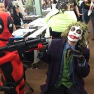 Kid Deadpool holds up the Joker at The Great Allentown Comic Con