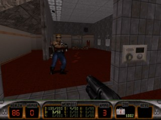 Duke Nukem checks himself out in mirror after killing some aliens - Duke Nukem 3D
