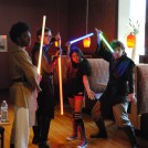 Dragon Jedi Performance Group pose with a fan at Lehigh Valley Fan Festival
