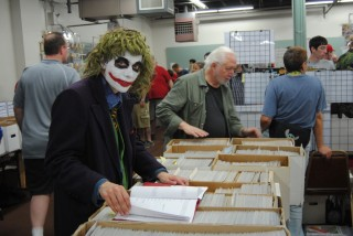 The Joker going through some short boxes at The Great Allentown Comic Con