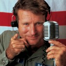 Robbin Williams as Adrian Cronauer in Good Morning, Vietnam