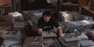 Rob Gordon with his huge collection of vinyl in High Fidelity