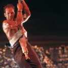 McClane hanging from a fire hose - Die Hard