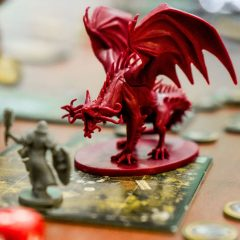D&D on TV, Dragon, human, person and dice by Clint Bustrillos on UnSplash